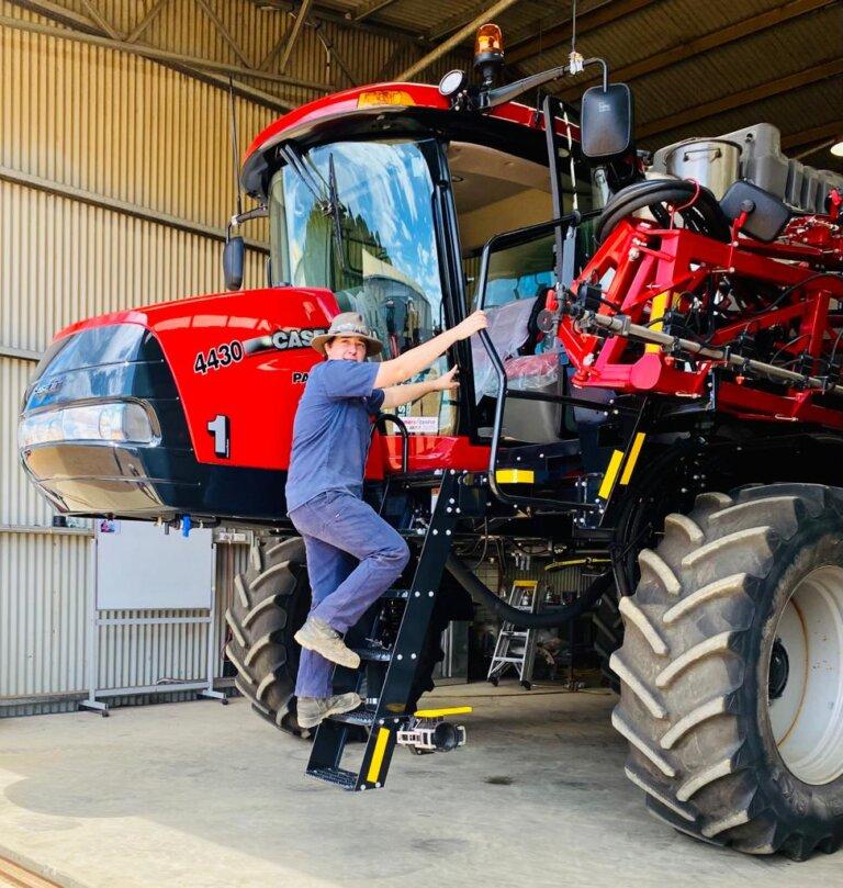 Hayden on a massve red tractor